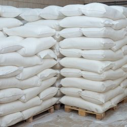 Sacks of flour on a pallet. Flour in the bags.